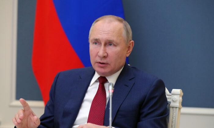 Russia's President Vladimir Putin attends a video conference during the World Economic Forum of the Davos Agenda, in Moscow on Jan. 27, 2021. (Sputnik/Mikhail Klimentyev/Kremlin via Reuters)