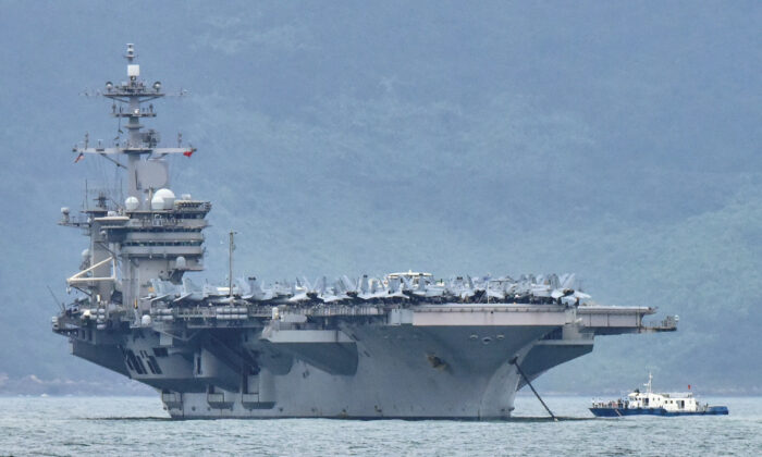 The USS Theodore Roosevelt (CVN-71) is pictured as it enters the port in Da Nang, Vietnam, on March 5, 2020. (Kham/File Photo/Reuters)