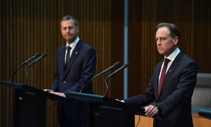 Minister for Health Greg Hunt (R) reacts during a press conference alongside Principle Medical Officer Professor Michael Kidd (L) at Parliament House in Canberra, Australia on March 24, 2020. (Sam Mooy/Getty Images)