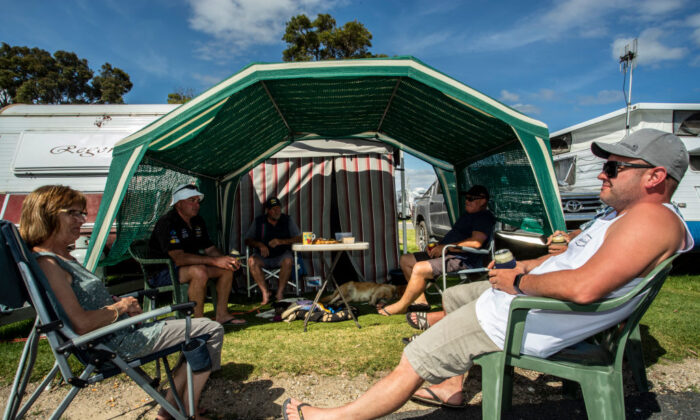 People gather for a holiday break at the caravan park on December 29, 2020 in Mallacoota, Australia. (Diego Fedele/Getty Images)