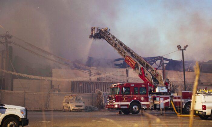 Firefighters battle a blaze in an industrial area in Passaic, N.J., on Saturday, Jan. 30, 2021. (Kevin Hagen/AP)