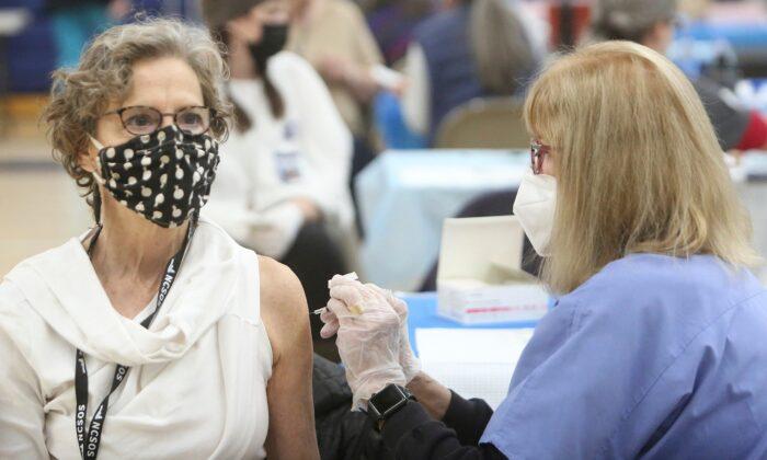 Investigation reveals no specific risk of COVID-19 vaccinations in elderly patients. (Elias Funez/The Union via AP)