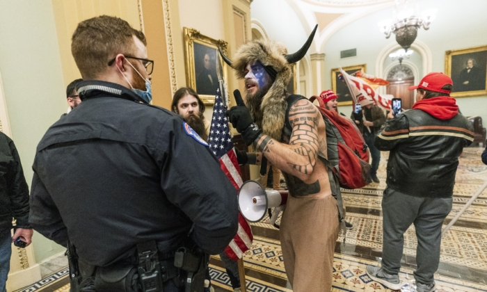 Jacob Chansley, center, and other protesters are seen inside the U.S. Capitol in Washington on Jan. 6, 2021. (Manuel Blace Ceneta/AP Photo)