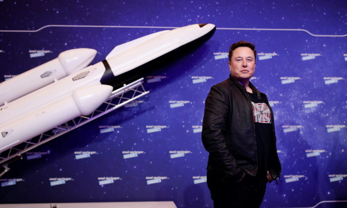 SpaceX owner and Tesla CEO Elon Musk poses after arriving on the red carpet for the Axel Springer award, in Berlin, Germany, on Dec. 1, 2020. (Hannibal Hanschke/Reuters)