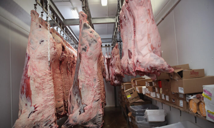 Beef and hog sides hang in the cooler awaiting processing in Elma, Iowa, on July 25, 2018. (Scott Olson/Getty Images)