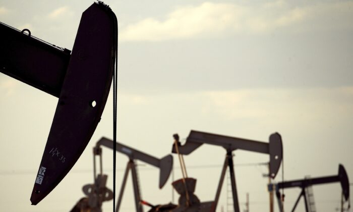 Pumpjacks work in a field in a file photo. (Charlie Riedel/AP Photo)