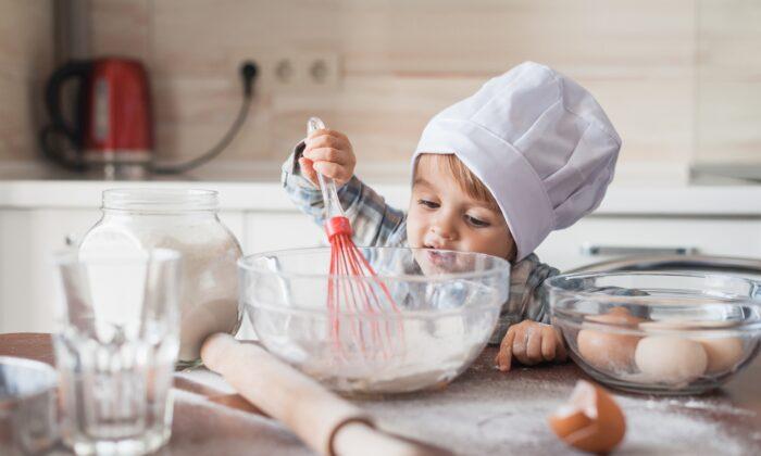 Kitchen tasks like stirring and mixing could help children develop their fine motor skills. (LightField Studios/Shutterstock)