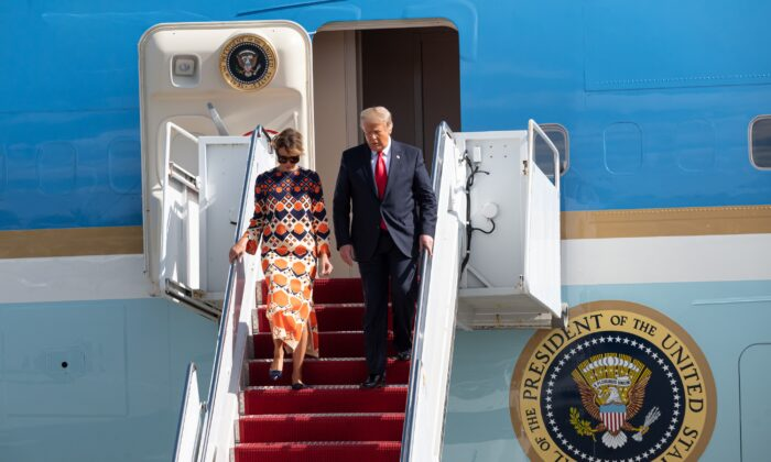 Outgoing President Donald Trump and First Lady Melania Trump exit Air Force One at the Palm Beach International Airport on the way to Mar-a-Lago in West Palm Beach, Fla., on Jan. 20, 2020. (Noam Galai/Getty Images)