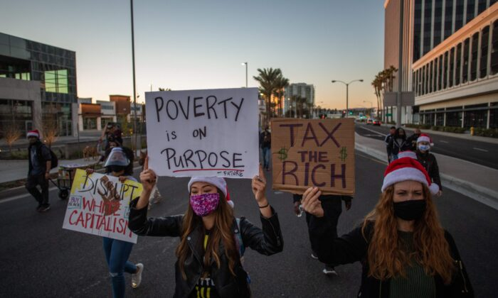Protesters march in Los Angeles during a Black Lives Matter rally to demand social justice on Dec. 19, 2020. (Apu Gomes/AFP via Getty Images)