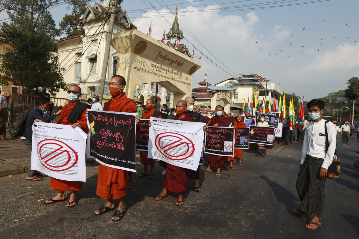 Buddhist monks hold placards
