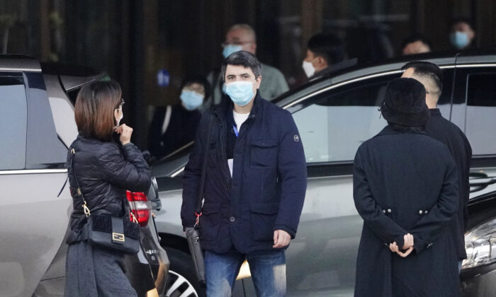 Vladmir Dedkov, center, of the World Health Organization team prepares to leave for a third day of field visit in Wuhan, China, on Jan. 31, 2021. (Ng Han Guan/AP Photo)