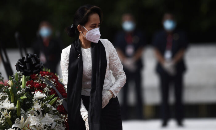 Burma's State Counsellor and Foreign Minister Aung San Suu Kyi leaves after paying her respects to her late father during a ceremony to mark the 73rd anniversary of Martyrs' Day in Yangon on July 19, 2020.  (Ye Aung Thu/Pool via Reuters)