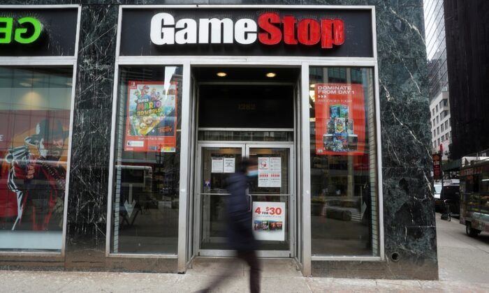 A person walks by a GameStop store in New York City on Jan. 27, 2021. (Carlo Allegri/Reuters)