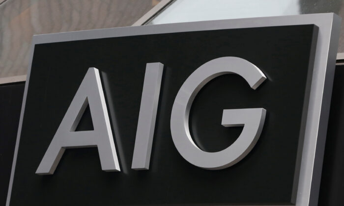 A sign is displayed over the entrance to the AIG headquarters offices at financial district in New York City, N.Y., on Jan. 9, 2013. (Brendan McDermid/Reuters)