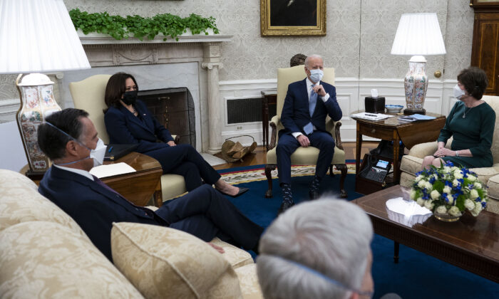 Joe Biden (Center R) and Vice President Kamala Harris (Center L) meet with 10 Republican senators, including Mitt Romney (R-Utah), Bill Cassidy (R-La.) and Susan Collins (R-Maine), in the Oval Office at the White House in Washington, on Feb. 1, 2021. (Doug Mills-Pool/Getty Images)
