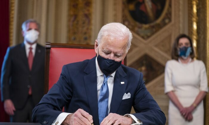 President Joe Biden signs documents including Cabinet nominations and sub-Cabinet nominations in the Presidents Room at the Capitol after the inauguration ceremony in Washington on Jan. 20, 2021.  (Jim Lo Scalzo-Pool/Getty Images)