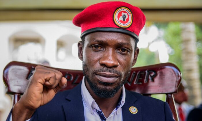 Opposition presidential challenger Bobi Wine gestures as he speaks to the media outside his house, in Magere, Uganda, on Jan. 26, 2021. (Nicholas Bamulanzeki/AP Photo)