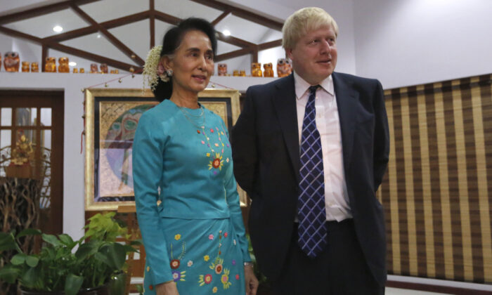 Burma's State Counsellor and Foreign Minister Aung San Suu Kyi (L) welcomes then-British Foreign Secretary Boris Johnson (R) in Naypyidaw, Burma, on Jan. 20, 2017. (Soe Zeya Tun/AFP via Getty Images)