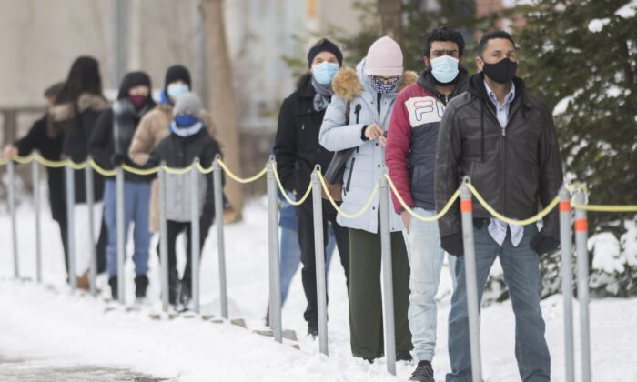 People wait to be tested for COVID-19 at a clinic in Montreal on Jan. 3, 2021. (The Canadian Press/Graham Hughes)