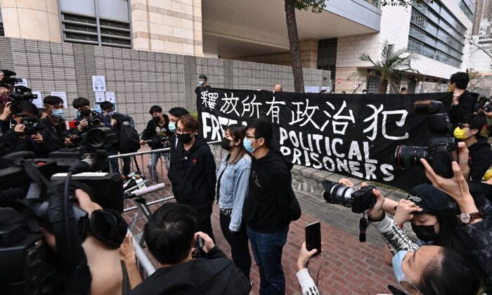 Figo Chan (3rd R), the convener of the pro-democracy group Civil Human Rights Front, speaks to the media outside of the West Kowloon Magistrates' Court in Hong Kong on March 1, 2021. (Sung Pi-lung/The Epoch Times)