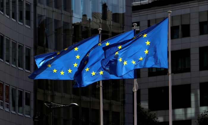 European Union flags flutter outside the European Commission headquarters in Brussels, Belgium, on Aug. 21, 2020. (Yves Herman/Reuters)