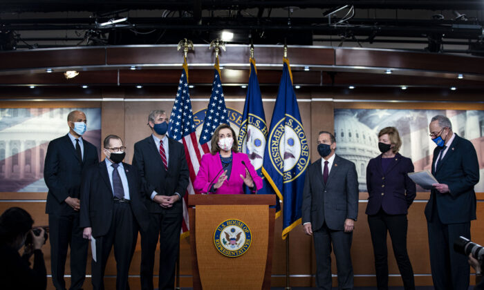 House Speaker Rep. Nancy Pelosi (D-Calif.) speaks as Sen. Cory Booker (D-N.J.), Rep. Jerry Nadler (D-N.Y.), Sen. Jeff Merkley (D-Ore.) (L), Rep. David Cicilline (D-R.I.), Sen. Tammy Baldwin (D-Wis.), and Senate Majority Leader Charles Schumer (D-N.Y.) (R) listen during a news conference ahead of the House vote on the Equality Act on Capitol Hill in Washington on Feb. 25, 2021. (Al Drago/Getty Images)