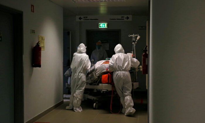 A patient is carried to the COVID-19 Intensive Care Unit (ICU) of Cascais Hospital in Cascais, Portugal, on Jan. 27, 2021. (Pedro Nunes/Reuters)