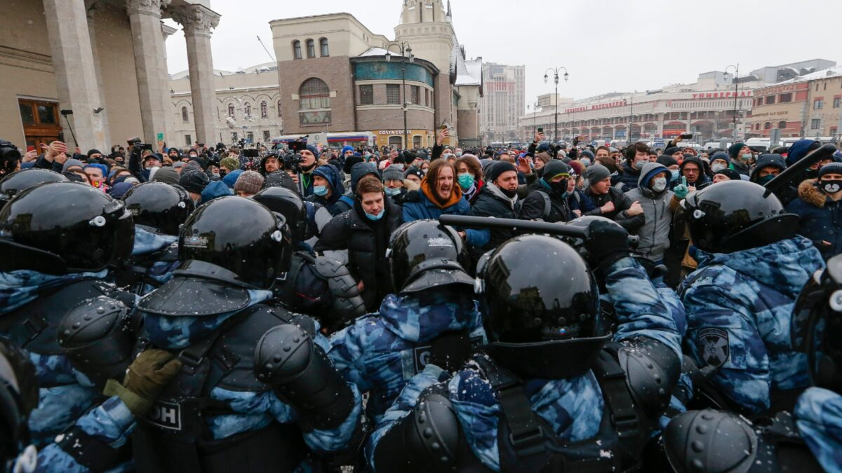 People clash with police during a protest