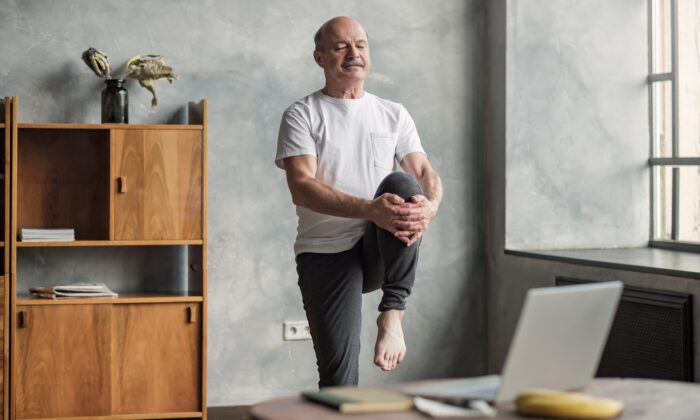There are many exercises that can  help you maintain good balance, including yoga, tai chi, and stretching exercises. (Koldunov/Shutterstock)