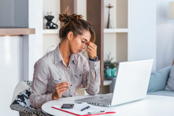 Young,Frustrated,Woman,Working,At,Office,Desk,In,Front,Of