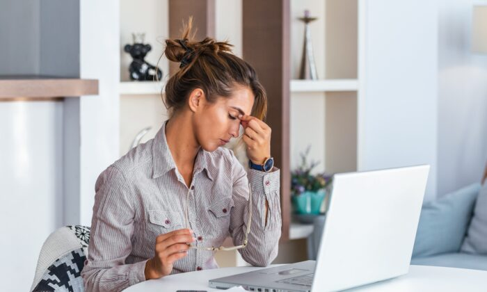 One type of headache, the tension headache, can arise when we try to take on too much and then suffer from the stress of it all.(Photoroyalty/Shutterstock)