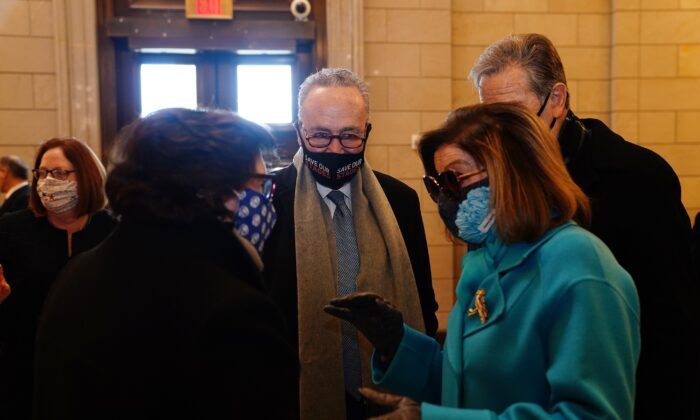 Senate Majority Leader Chuck Schumer (D-N.Y.), center, and House Speaker Nancy Pelosi (D-Calif.), second from right, are seen in Washington on Jan. 20, 2021. (Jim Lo Scalzo/Pool/Getty Images)