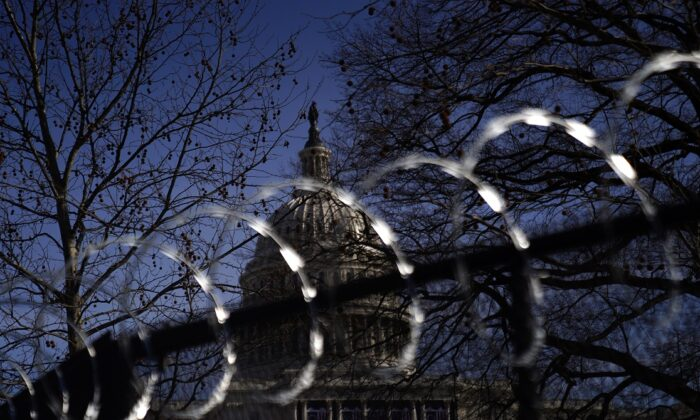 Concertina wire tops security fencing around the U.S. Capitol in Washington on Jan. 16, 2021. (Eric Thayer/Getty Images)