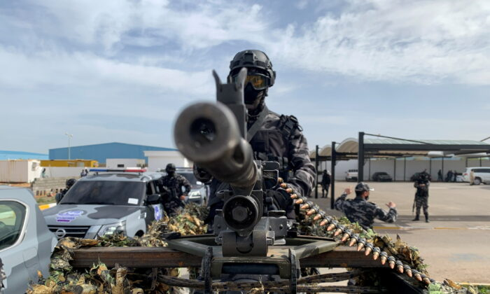 A member of security forces stands behind a weapon, in Tripoli, Libya Feb. 1, 2021.  (REUTERS/Ayman Al-Sahili)