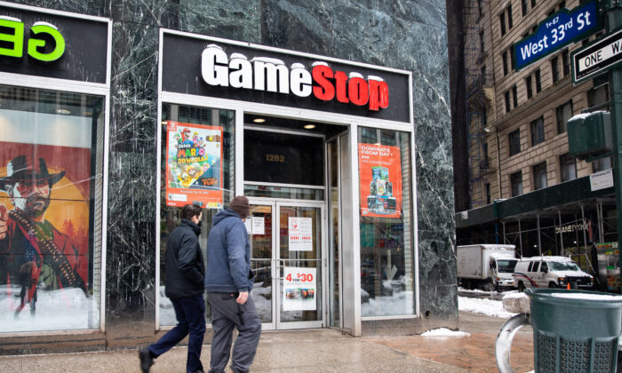 People walk past a GameStop store in New York on Feb. 2, 2021. (Chung I Ho/The Epoch Times)