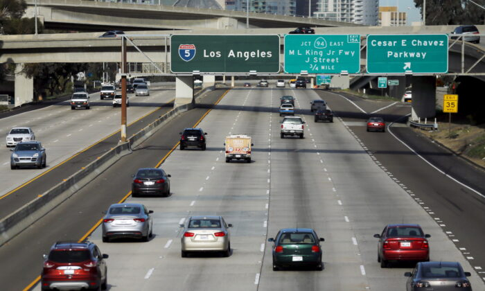 Cars travel north towards Los Angeles on interstate highway 5 in San Diego, Calif., on Feb. 10, 2016. (Mike Blake/Reuters)