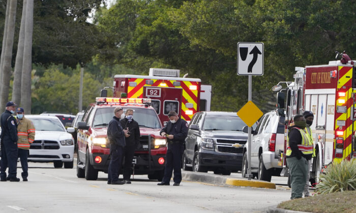 Law enforcement officers block an area where a shooting wounded several FBI agents while serving an arrest warrant in Sunrise, Fla., on Feb. 2, 2021. (Marta Lavandier/AP Photo)