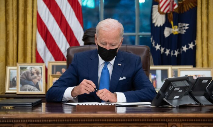 President Joe Biden signs executive orders related to immigration at the White House in Washington on Feb. 2, 2021. (Saul Loeb/AFP via Getty Images)