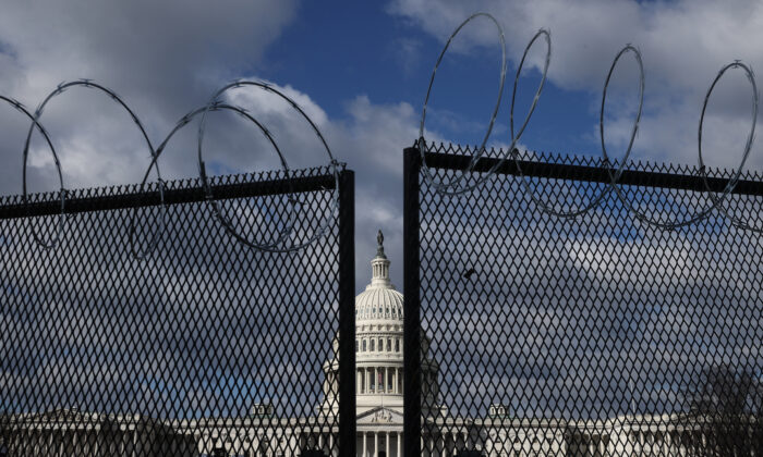 An 8-foot-tall steel fence topped with concertina razor wire circles the U.S. Capitol in Washington on Jan. 29, 2021. (Chip Somodevilla/Getty Images)