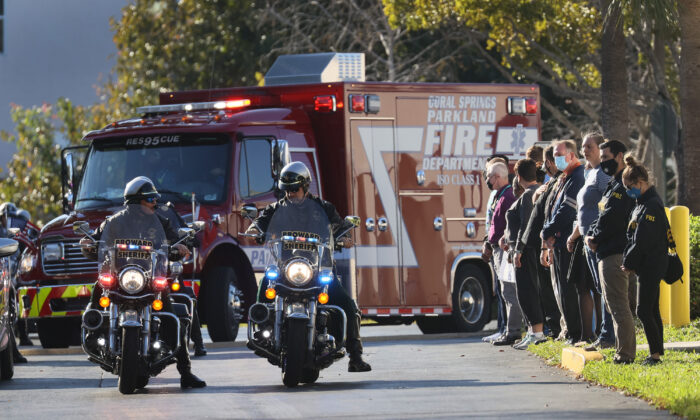 Broward County, Fla., sheriff's officers escort a Coral Springs Parkland Fire Department vehicle as it leaves the Broward County Office of Medical Examiner following the killing of two FBI agents during the serving of a warrant in Sunrise, Fla. (Joe Raedle/Getty Images)