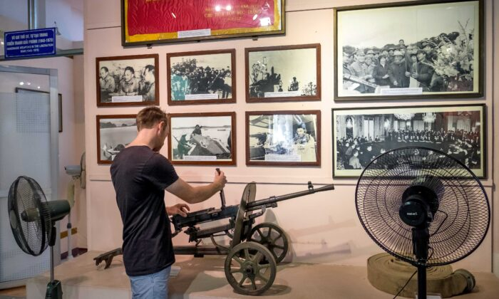 A visitor tries out the machine gun at Vietnam Military History Museum in Hanoi, Vietnam, on May 25, 2016. (Linh Pham/Getty Images)