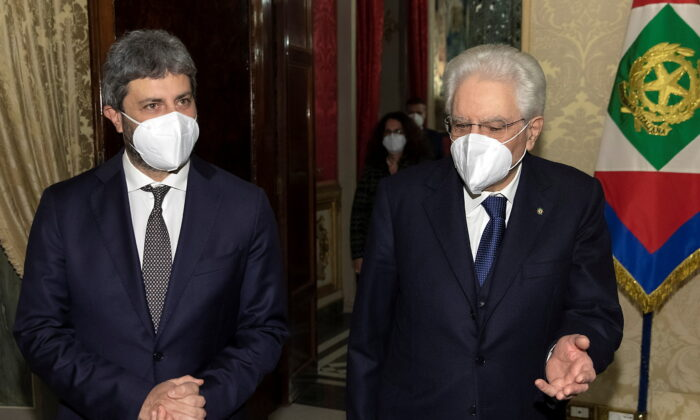 Italian President Sergio Mattarella meets with Roberto Fico, head of the lower house of parliament, in Rome, Italy on Feb. 2, 2021. (Paolo Giandotti/Presidential Palace/Handout via Reuters)