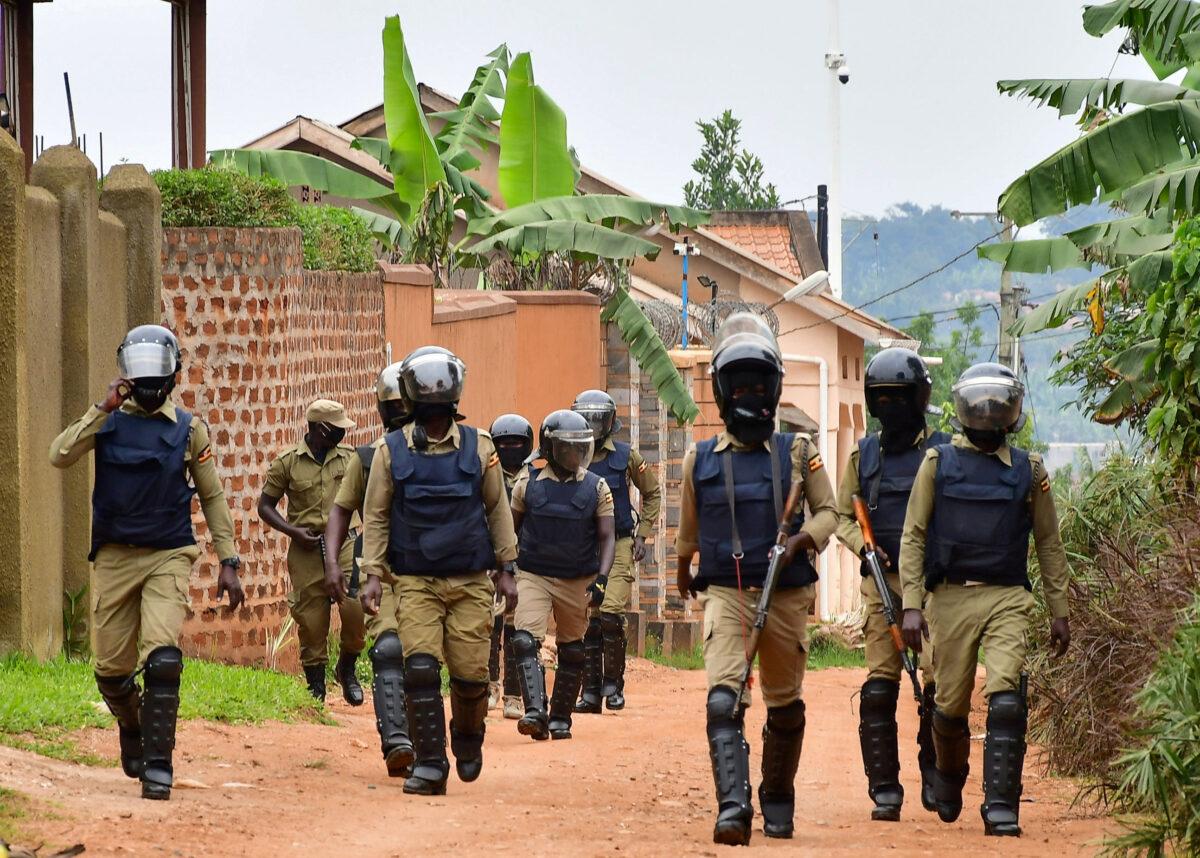 Ugandan policemen patrol near the house of Bobi Wine