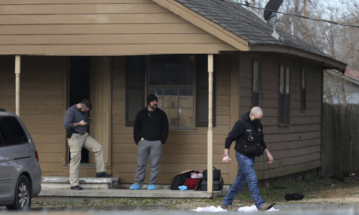 Investigators work at the scene of a suspected mass homicide where at least 5 children were slain in Muskogee, Okla on Feb. 2, 2021 (AP)
