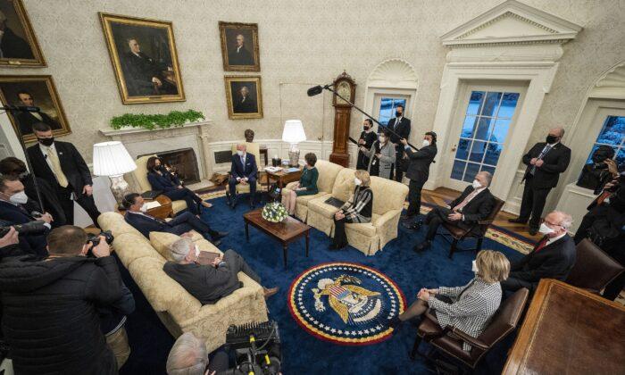 President Joe Biden and Vice President Kamala Harris meet with 10 Republican senators, including Sens. Mitt Romney (R-Utah), Bill Cassidy (R-La.), Susan Collins (R-Maine), and Lisa Murkowski (R-Alaska), in the Oval Office at the White House in Washington on Feb. 1, 2021. (Doug Mills/Pool/Getty Images)