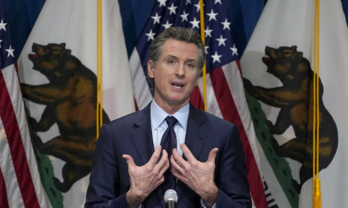 California Gov. Gavin Newsom outlines his 2021–22 state budget proposal during a news conference in Sacramento, Calif., on Jan. 8, 2021. (Rich Pedroncelli/Pool/AP Photo)