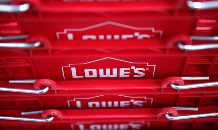 The Lowe's logo is displayed on shopping baskets during the grand opening of the Lowe's store in San Francisco, California, on Nov. 4, 2010. (Justin Sullivan/Getty Images)