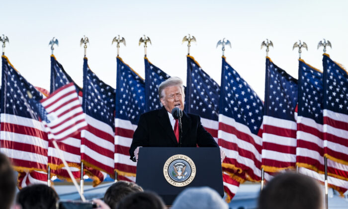 President Donald Trump speaks to supporters before boarding Air Force One for his last time as president at Joint Base Andrews, Md., on Jan. 20, 2021. (Pete Marovich/Pool/Getty Images)