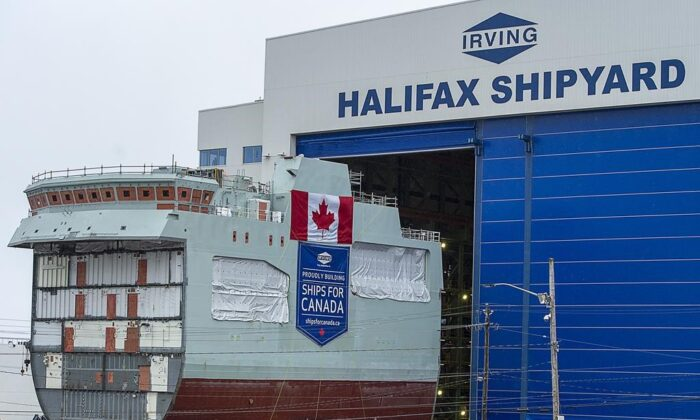 The centre block of the future HMCS Max Bernays is moved from the fabrication building to dockside at the Irving Shipbuilding facility in Halifax on Friday, Jan. 22, 2021.The vessel is Canada's third Arctic and Offshore Patrol Ship (AOPS) being built for the Royal Canadian Navy. (Andrew Vaughan/The Canadian Press)