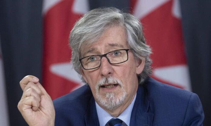 Privacy commissioner Daniel Therrien speaks during a news conference in Ottawa, on Dec. 10, 2019. (Adrian Wyld/The Canadian Press)